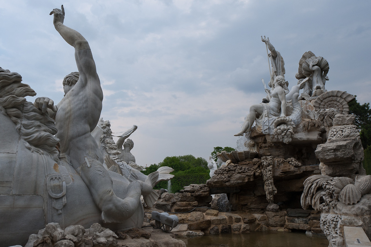Sculptures and man-made pond at the Schonbrunn Palace complex - Vienna, Austria