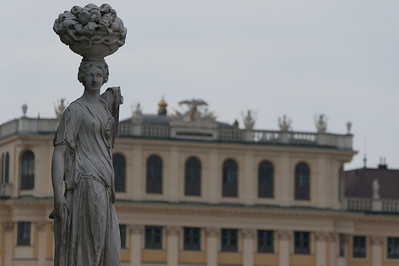 Sculpture with Schonbrunn Palace as background - Vienna, Austria
