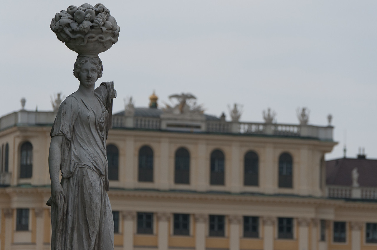 Sculpture with Schonbrunn Palace as background - Vienna, Austria