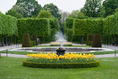 Fountain and beautiful flowers at the Schonbrunn Garden - Vienna, Austria