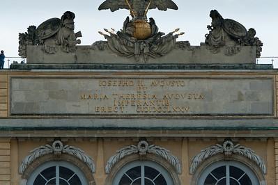 Sign underneath sculptures in Schonbrunn Garden - Vienna, Austria