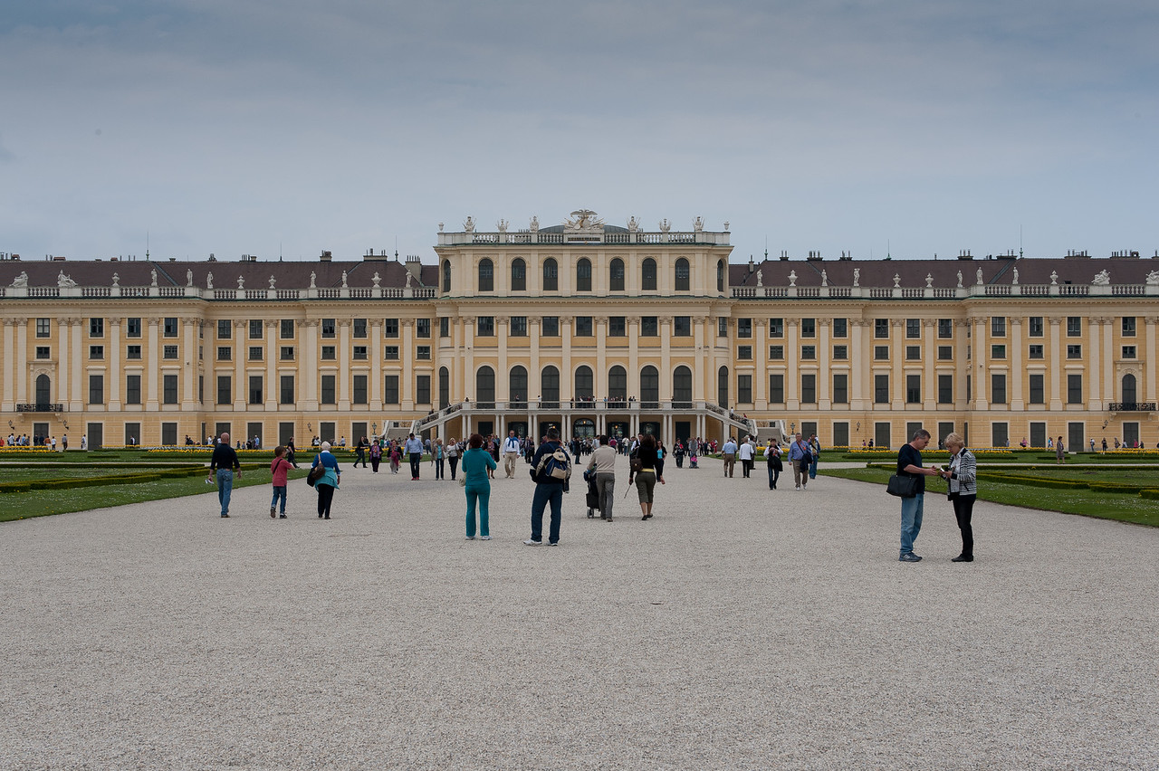 Tourists exploring the grounds of Schonbrunn Palace - Vienna, Austria