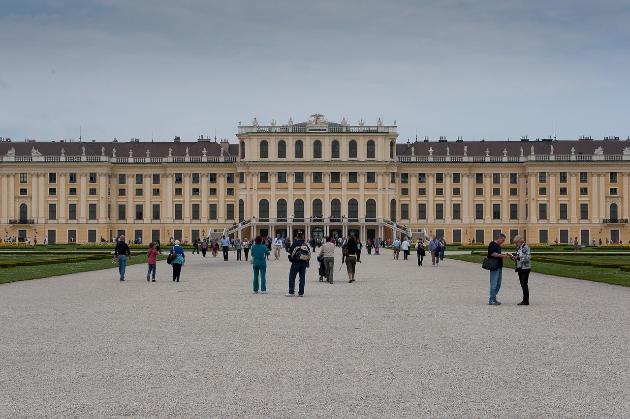 Tourists exploring the grounds of Schonbrunn Palace - Vienna, Austria