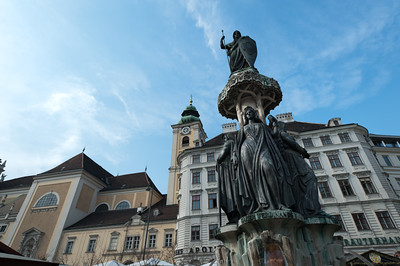 The Austriabrunnen statue in the middle of Austria Fountain - Vienna, Austria