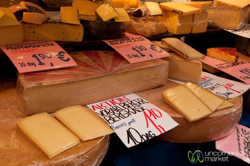 Large Wheels of Cheese at Brunnenmarkt - Vienna, Austria