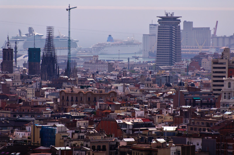 Barcelona, Spain. View of the Harbor with cruise ship RCI Navigator of the Seas.