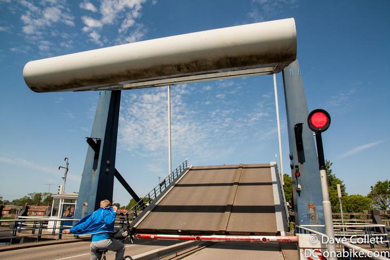 Drawbridge rising for the boat