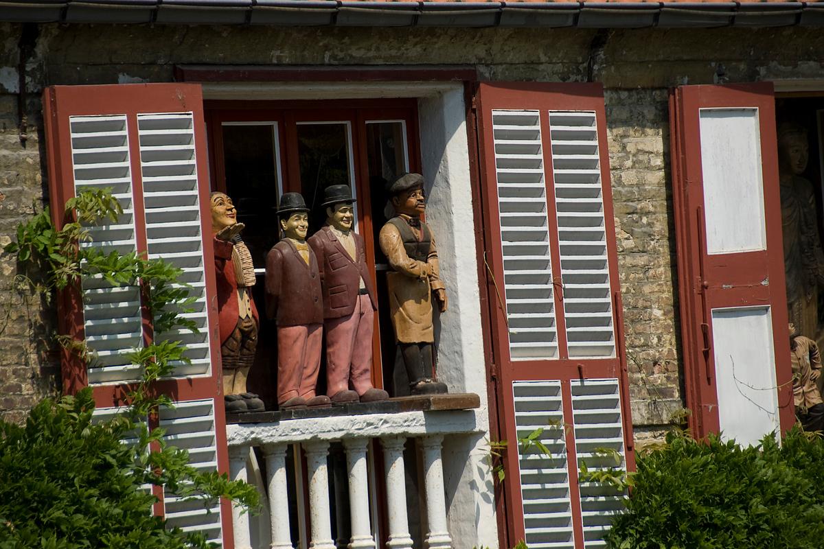 Wooden statues in a window, Brugge, Belgium