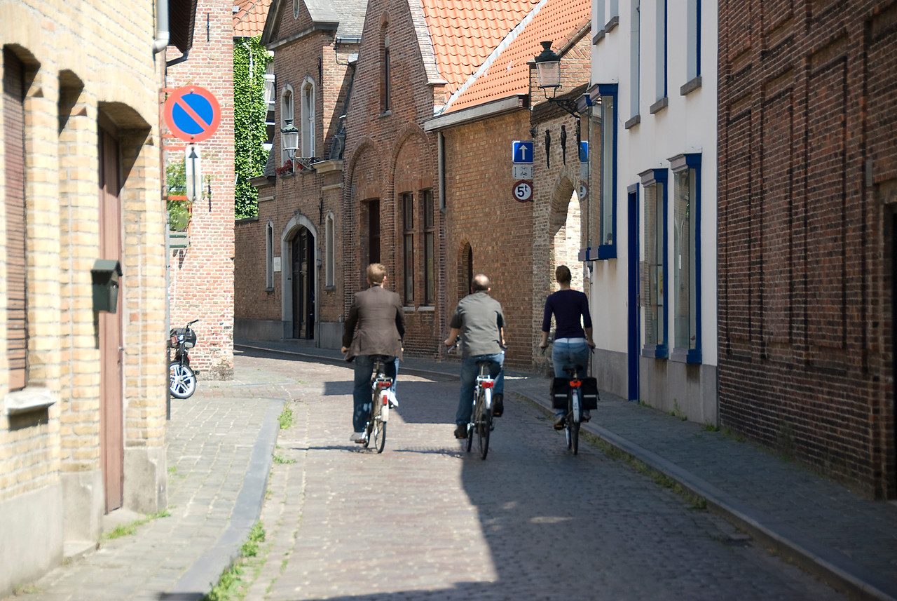 Bikers on a side street in Bruges, Belgium