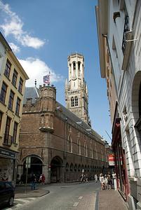 Belfry of Bruges rising above buildings in Burges, Belgium