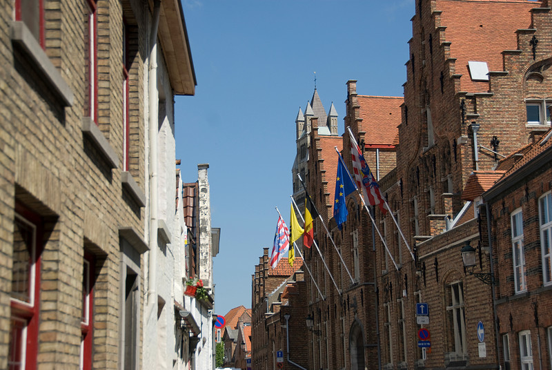 Flags and historic building on the main square Bruges, Belgium