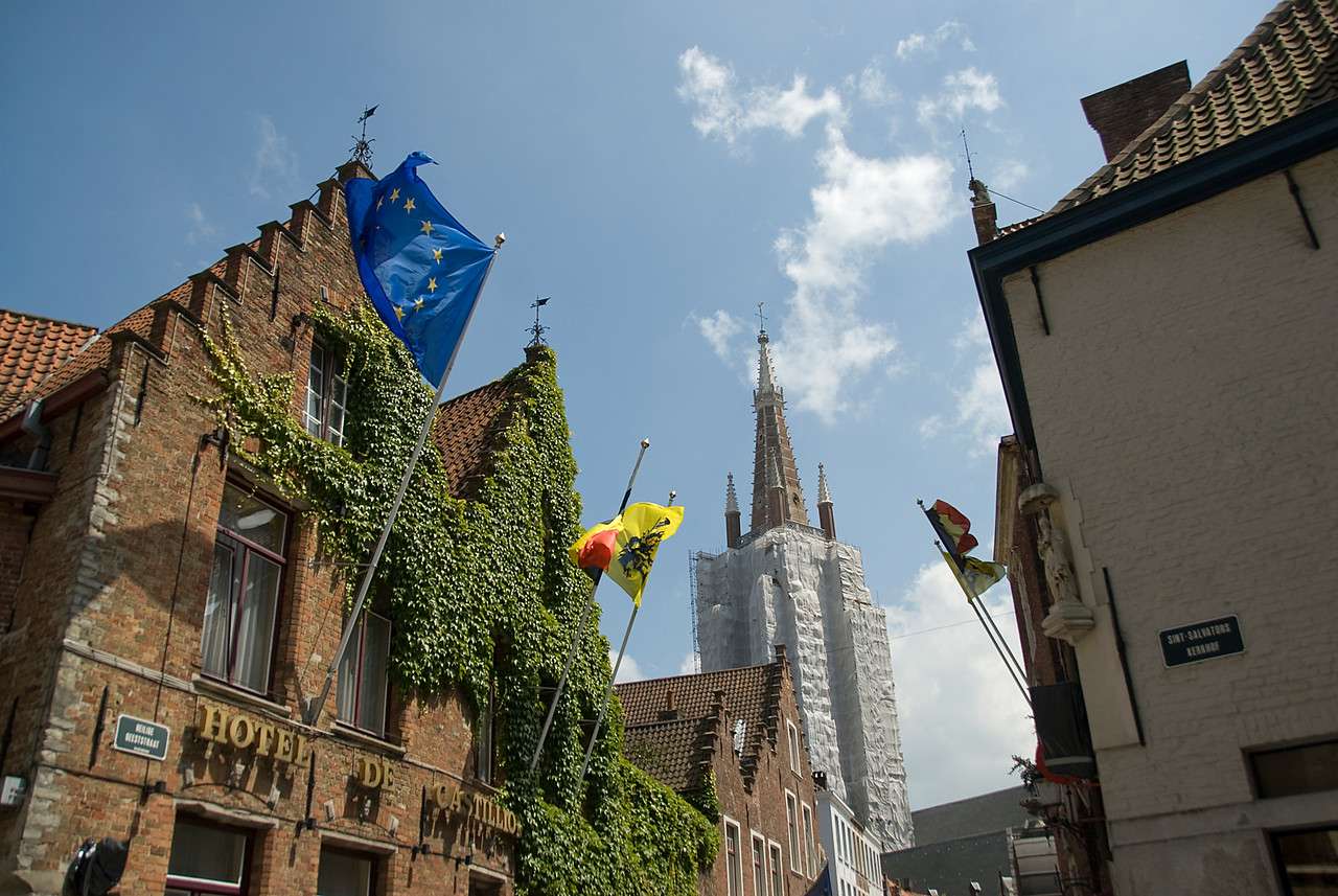 Flags waving outside Hotel de Castillo - Burges, Belgium