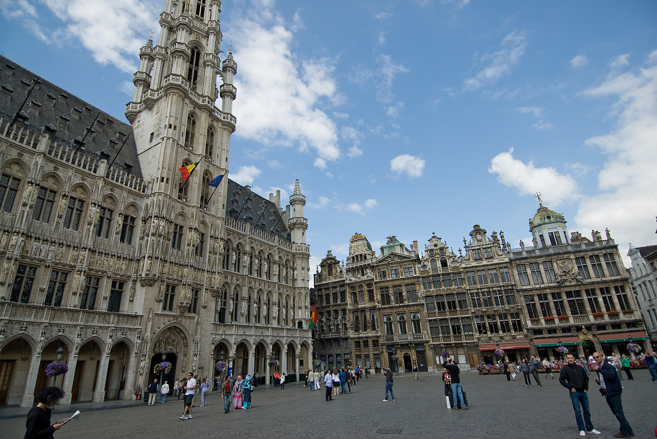 Tourists exploring the plaza outside Brussels Town Hall - Belgium