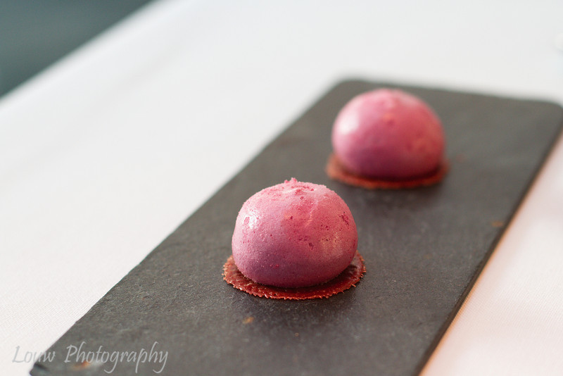 Amuse bouche of cherry macaron with goose liver and coca cola, Hertog Jan, Brugge, Belgium