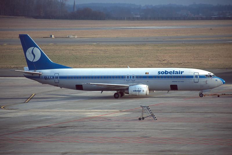 """OO-SBM Boeing 737-429 """"Sobleair"""" c/n 25729 Brussels/EBBR/BRU 03-03-96 (35mm slide)"""
