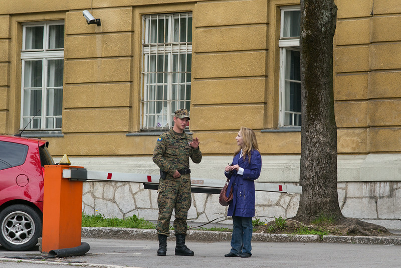 Bosnian soldier explaining to Rebecca how to get to Franz Ferdinand assassination site