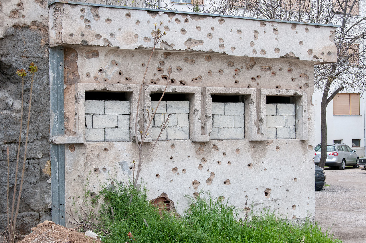 Bullet holes through an old structure - Mostar, Bosnia and Herzegovina