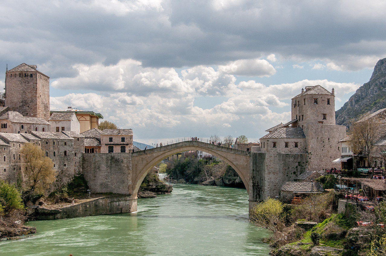 The stone arch bridge and nearby villages near Neretva River - Mostar, Bosnia and Herzegovina