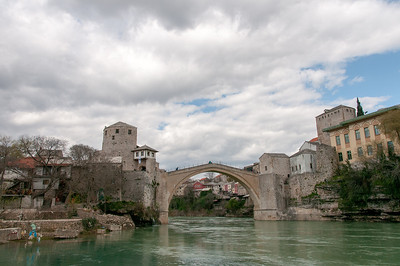 Cloudy sky above the stone arch bridge and Neretva River in Mostar, Bosnia and Herzegovina