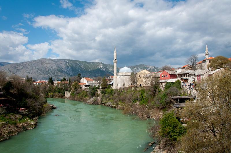 Calm Neretva river near the village and Hadzi Alija Mosque in Mostar, Bosnia and Herzegovina