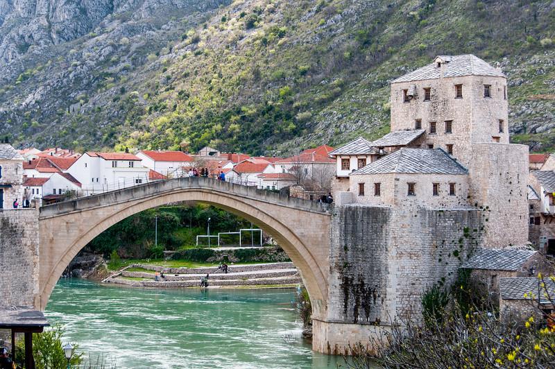 Close up shot of stone arch bridge across the Neretva River at Mostar, Bosnia and Herzegovina