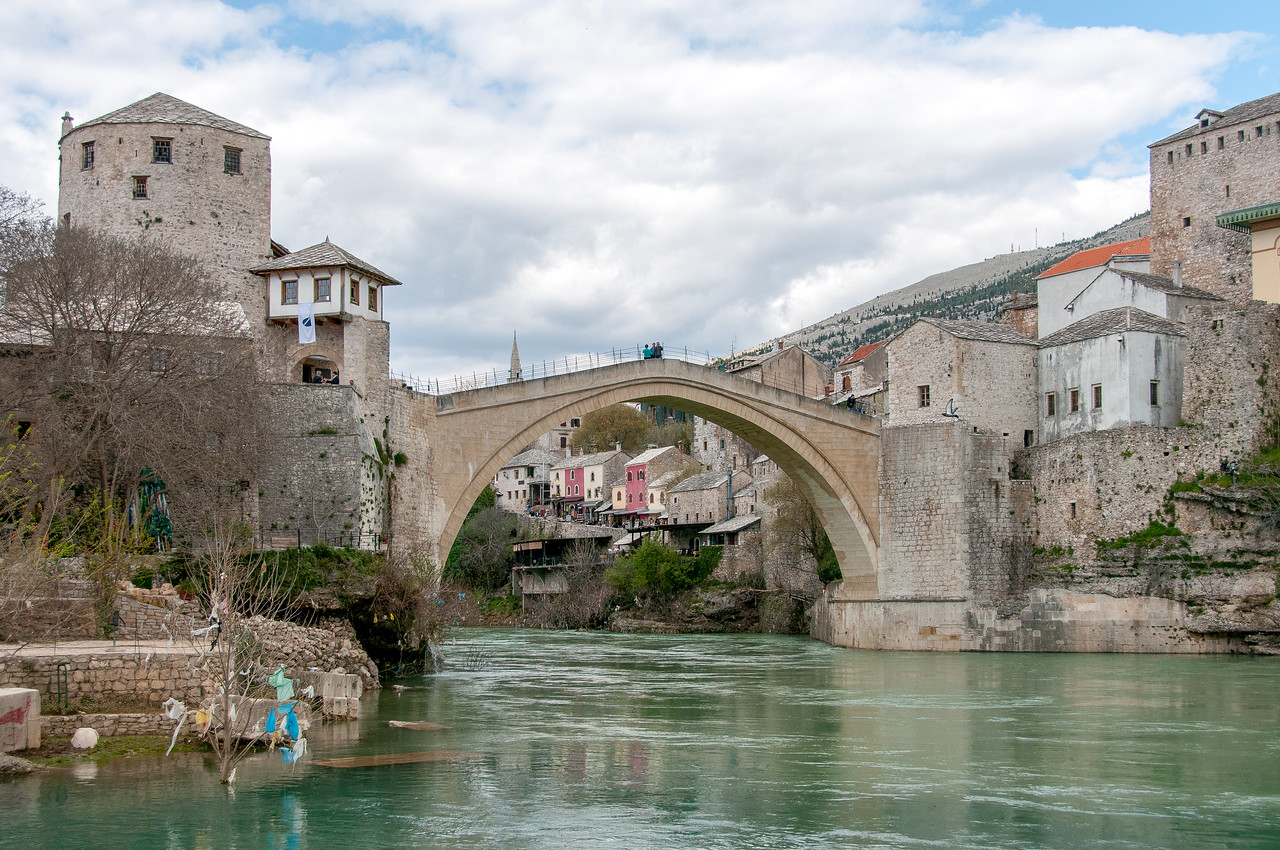 Tourists on the stone arch bridge at Mostar, Bosnia and Herzegovina