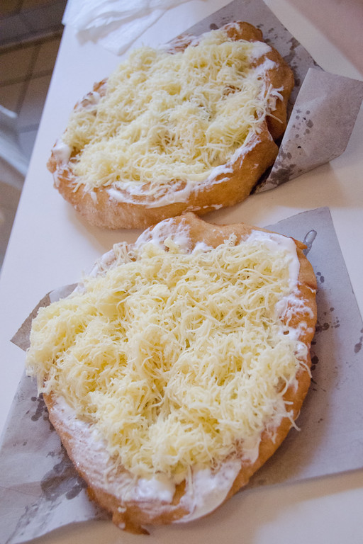 Things to eat + drink in Budapest | Langos, fried dough covered with cheese, sour cream, and garlic