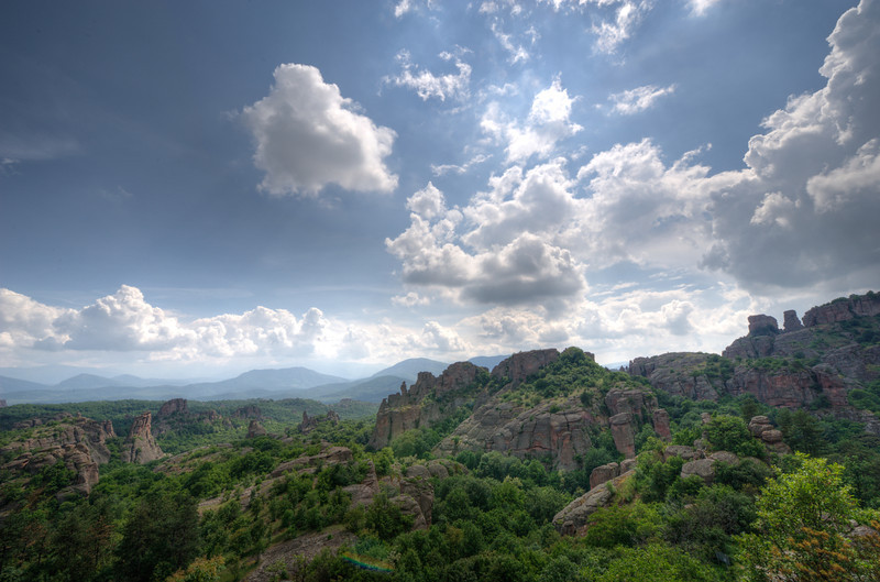 Beautiful clouds hovering above forest canopy in Belogradchik, Bulgaria
