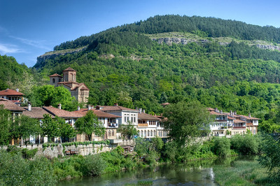 Beautiful shot of lush canopy and houses in Veliko Tarnovo, Bulgaria