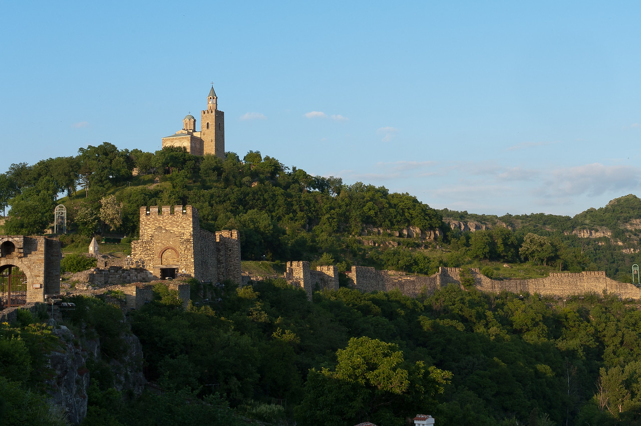 Tower of The Patriarchal Cathedral of the Holy Ascension of God peeking out over Tsarevets Hills - Veliko Tarnovo, Bulgaria