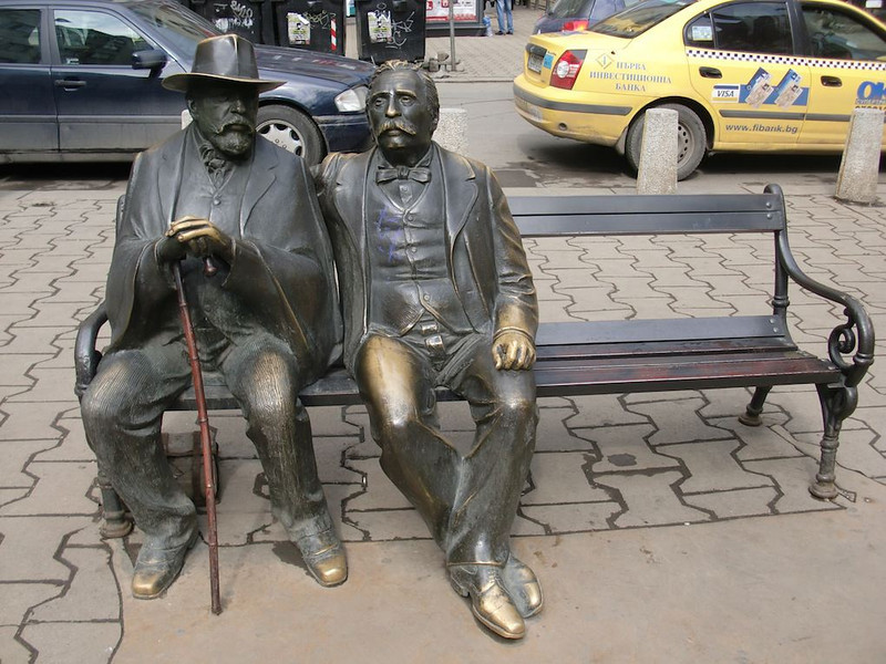 men statue sitting on a bench bulgaria