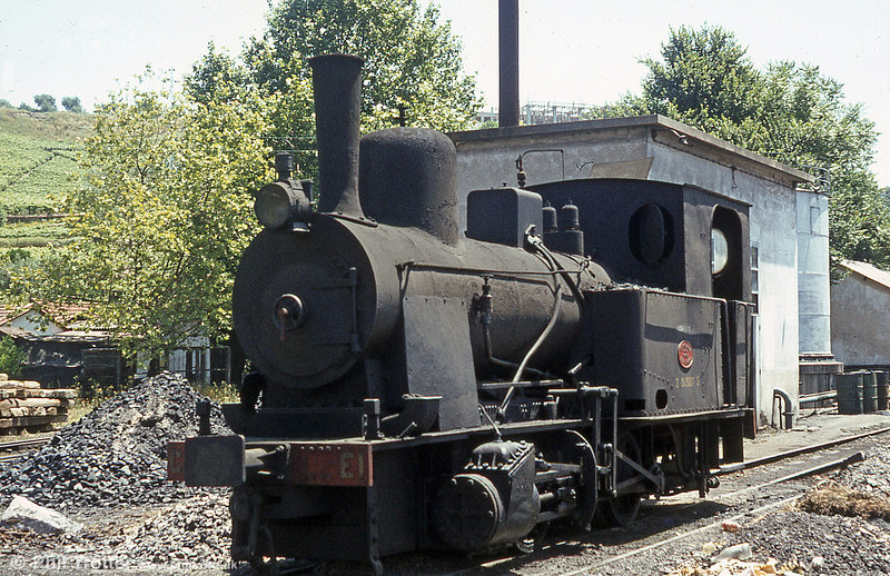 The last working (i.e. non-preserved) steam locomotive on the Portuguese system....? This was metre gauge Henschel 0-4-0T no. E1 of 1922 cooling off in June, 1983. The loco has since been preserved and is on display at Peso da Régua station.