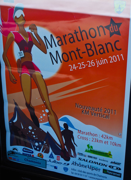 Sign for the marathon in a storefront window