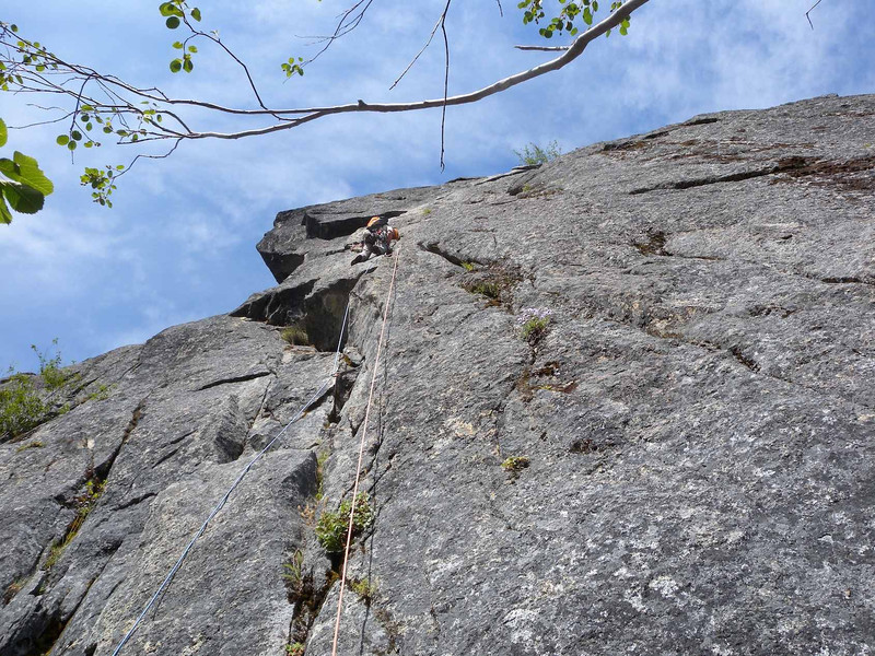 Halfway up crux pitch, which finishes with an airy traverse right.