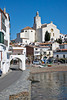 Cadaqués church, narrow road and beach, Catalonia, Spain