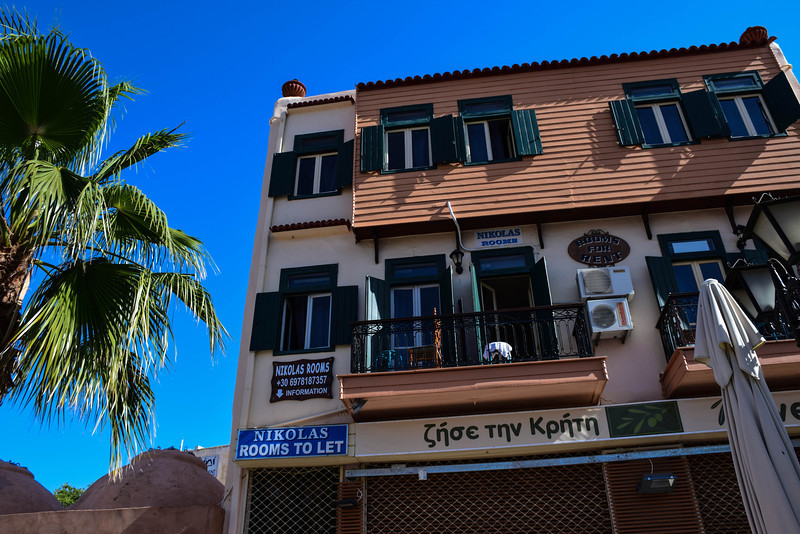 Our first hotel in Chania, Nikolas Rooms. The balcony above and to the right of the sign was ours.