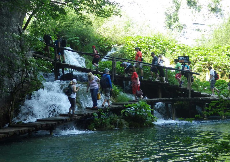 """Here we are hiking the constructed trails in Plitvice, along with a few thousand other tourists, glad we were there  before the """"busy"""" season."""