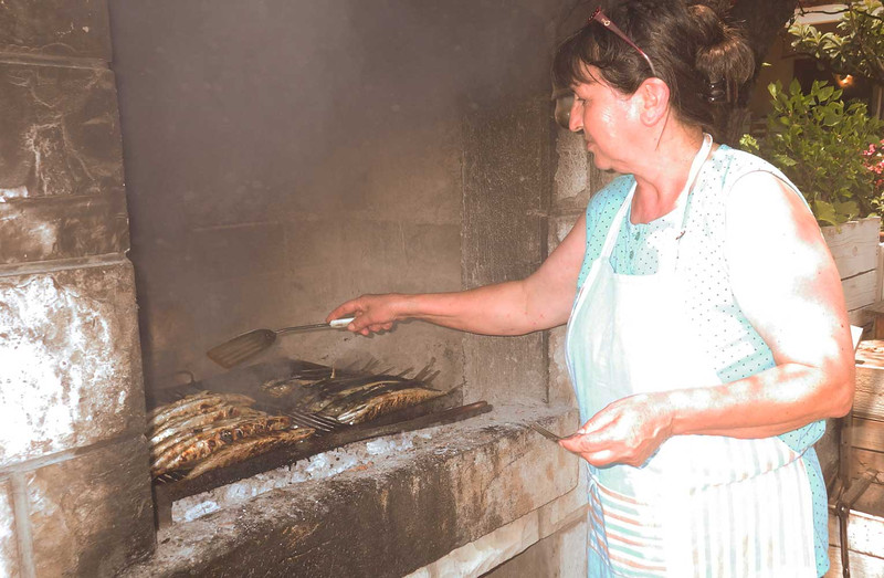 Our meals often offered freshly caught fish cooked over an open fire.  Typically Grandma would do the cooking and granddaughter would be our server.