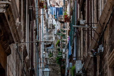 Clotheslines and steel stairs at an alley in Dubrovnik, Croatia