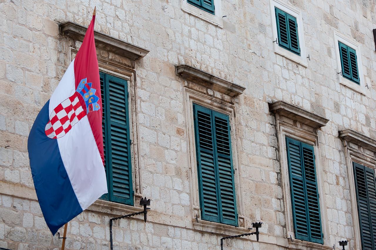 Croatian flag waving at a window - Dubrovnik, Croatia