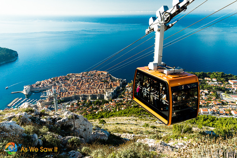 Passengers in the cable car and view from top of Mt Srd. this is a top must do in dubrovnik croatia.