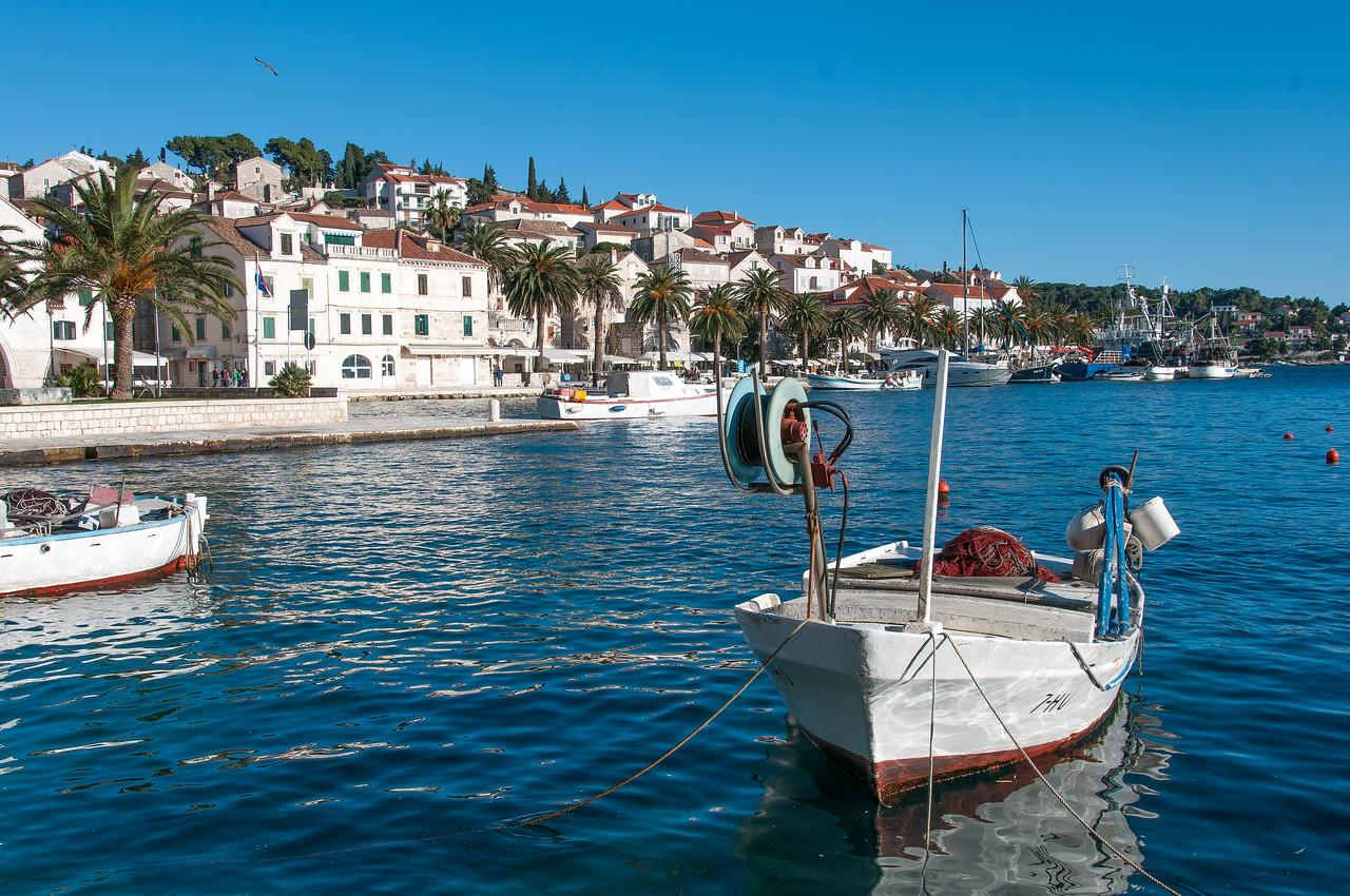 Boat tied by rope in harbor - Hvar, Croatia