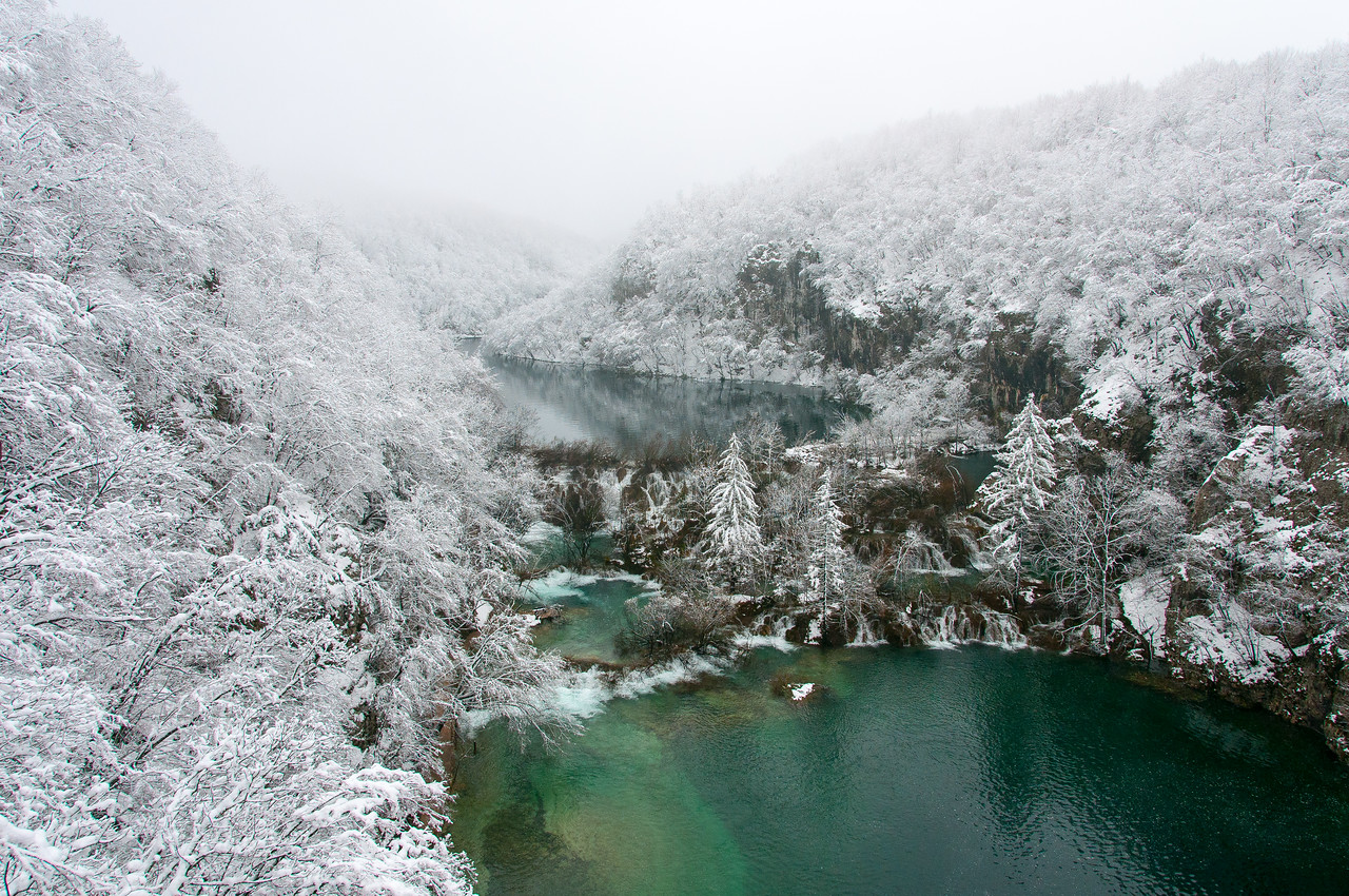 Beautiful snowy canopy near the lake in Plitvice National Park - Croatia