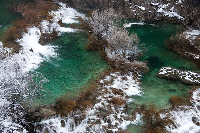 Green lake against a sea of white in Plitvice National Park - Croatia