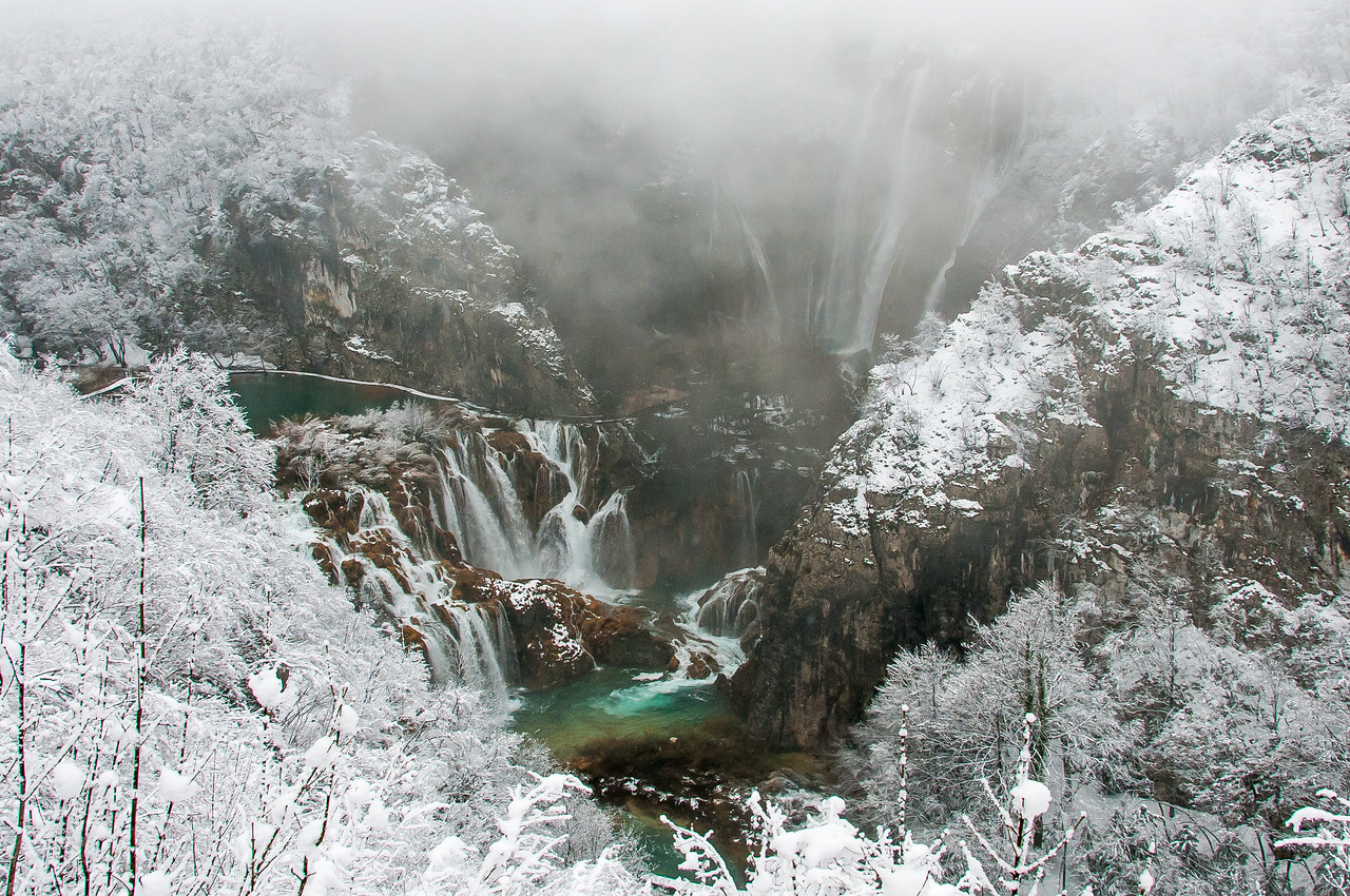 Mist and snow covering the lake in Plitvice National Park - Croatia