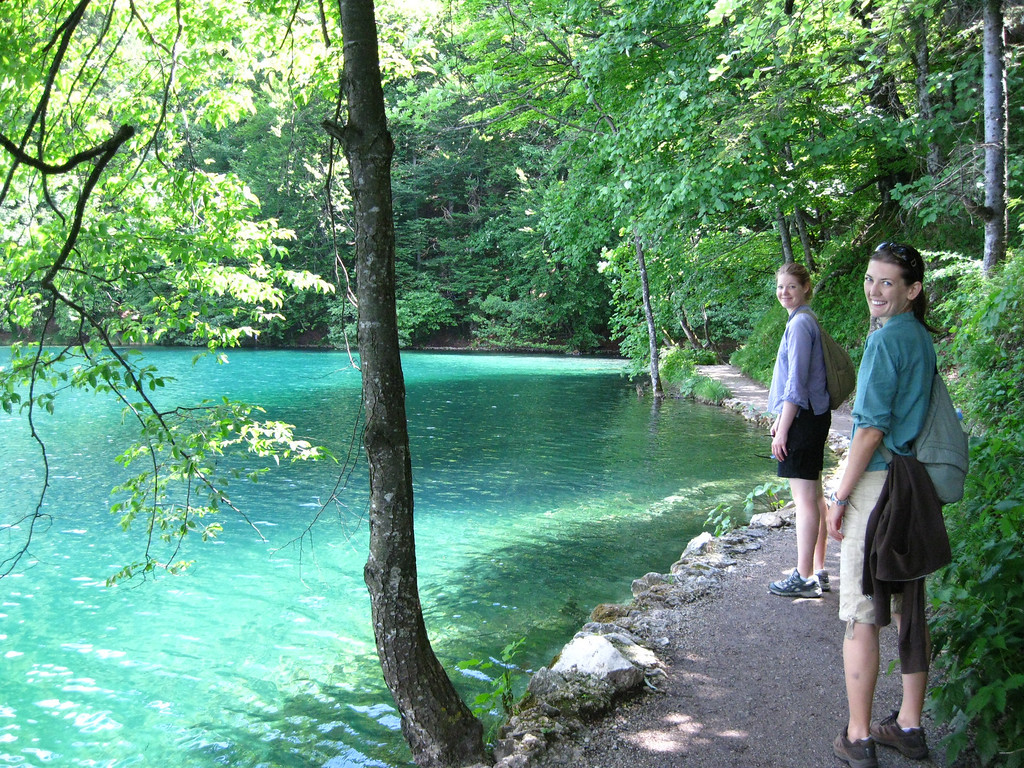 A pretty path that hugs a stunning blue lake at Plitvice National Park