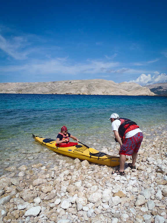 Kayaker and Guide pull on to shore in Croatia