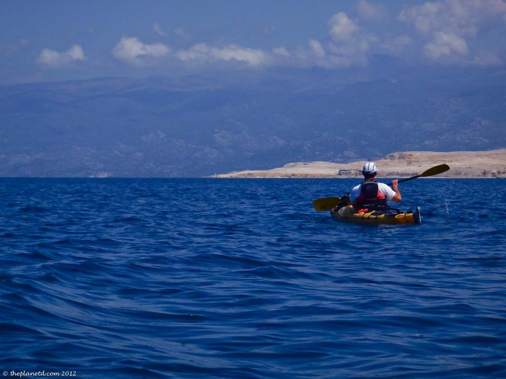 three people posing by kayaks in croatia