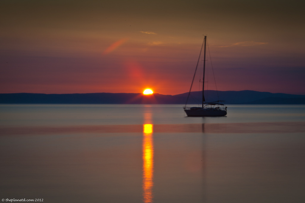 Sunset over sail boat on adriatic sea