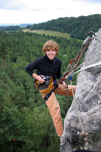 Christopher had not climbed anything in such a way before and learned nicely. He didn't seem to mind being so high and hanging from ropes either. Here he takes pictures from our anchor and belaying system. I didn't have much gear but I felt I made a pretty good and safe system.